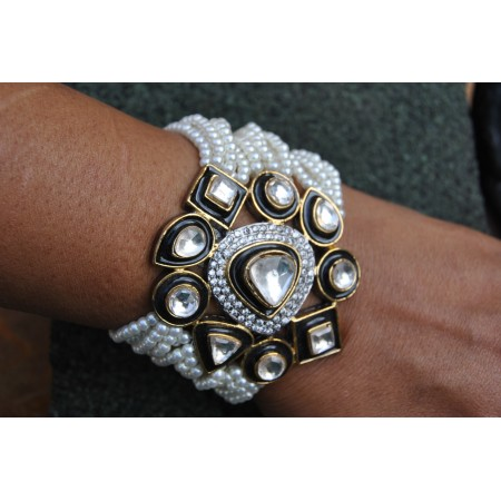 Multistring Pearl Bracelet Studded with Uncut Diamonds